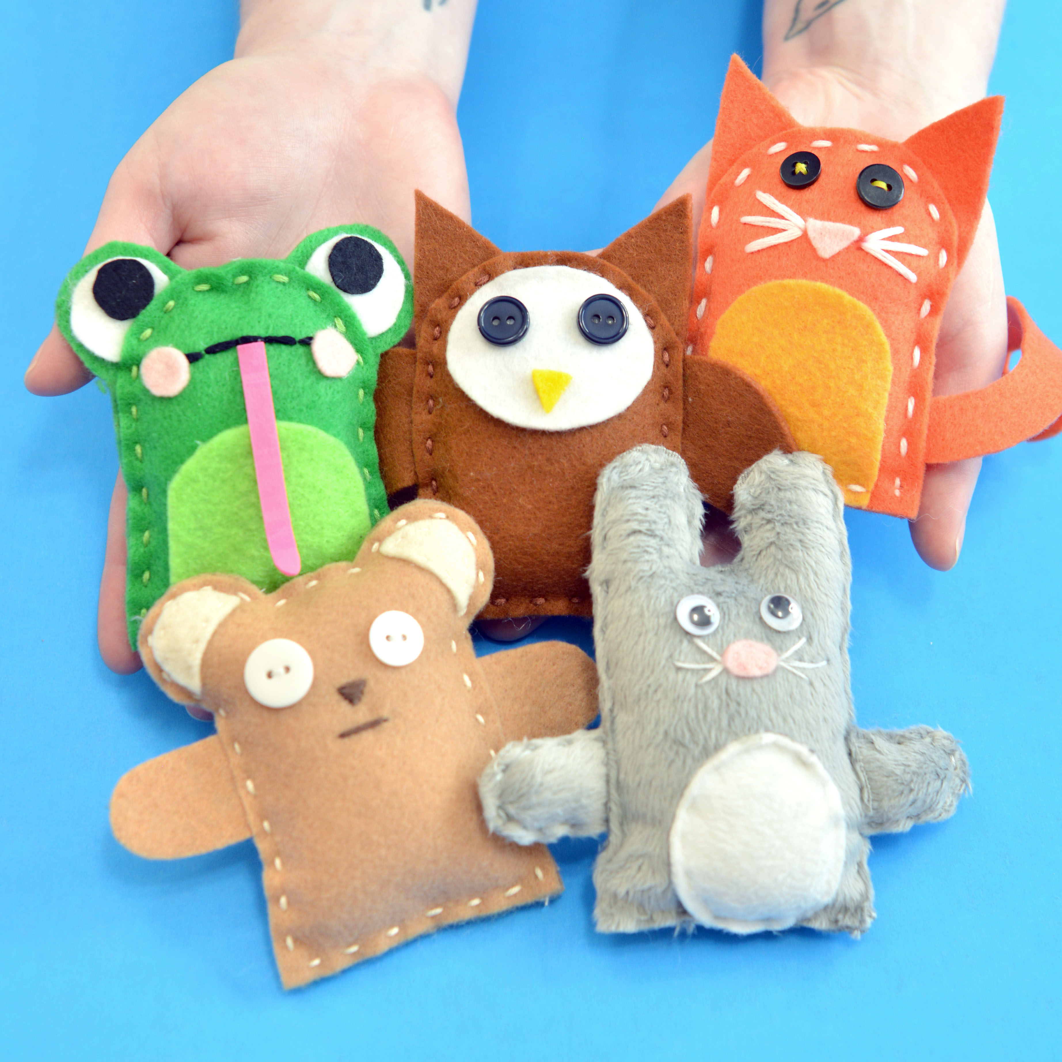 Hands holding handmade plushie examples: a frog, owl, cat, bear, and bunny.