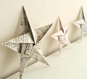 A photograph of a three pieces of paper folded into star shapes