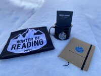 Denver Public Library Winter of Reading prizes include a mug, a notebook and a neck gaiter