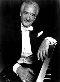 Victor Borge sitting at a piano.