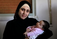 A Syrian refugee with newborn baby