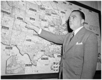 J. Edgar Hoover. FBI director J. Edgar Hoover reviews a map in his office locating the bureau's offices and operations across the United States in 1942. AP IMAGES.