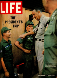 Life magazine cover with Lyndon Johnson talking to troops in Vietnam