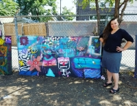 Artist/guide, Leah Hughes, in front of one of the finished panels.