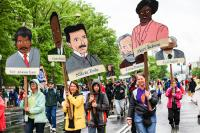 Science March photo. Marchers carrying pictures of notable scientists.