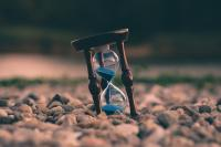 Picture of an hourglass with blue sand