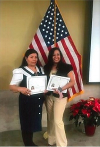 Photograph of women with naturalization certificates