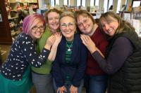 Photograph of Sallie Lipschuetz surrounded by her Park Hill Branch Library pals