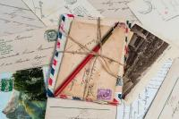 Stack of vintage postcards tied with twine.