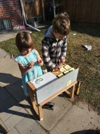 Photo of two children making crafts