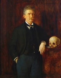 Ambrose Bierce, posing with an erstwhile critic