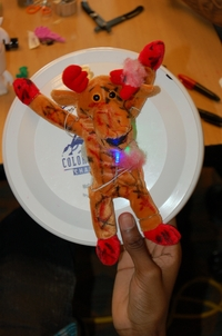 Creation from ideaLAB toy hack - a moose strapped to a frisbee with LEDs.