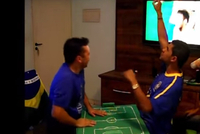 Carlos celebrates Brazil's score with his friends.