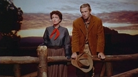 Vienna and Johnny Guitar (Sterling Hayden) find a stolen moment