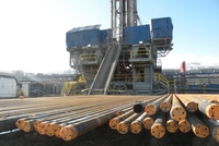 drilling rig, pipe, & well pad - Piceance Basin, CO. Photo by Tim Hurst