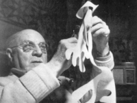 Matisse working on his cutouts, circa 1948