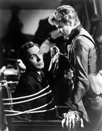 Ingrid Bergman confronting Charles Boyer in a climactic scene.