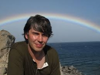 professor brian cox is so awesome he always has a rainbow behind him.