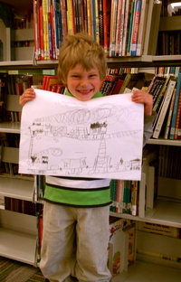 Lukas holding his train drawing.
