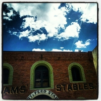 It was a blue sky kind of day in Central City. Over the roof of the stables.