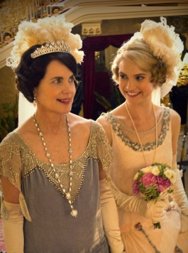 Two characters from Downton Abbey in their beautiful dresses
