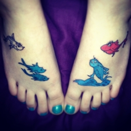 Picture of a pair of feet with Dr. Seuss inspired tattoos