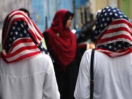 Women wearing American flag head scarves.