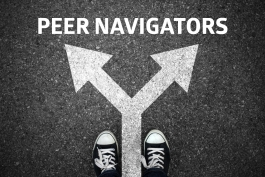 "Photo of street with arrows indicating a choice of direction and the words ""peer navigator"""
