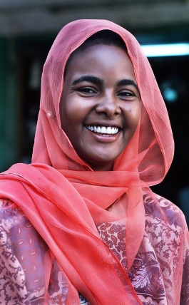 Smiling woman from Sudan - Courtesy of Creative Commons