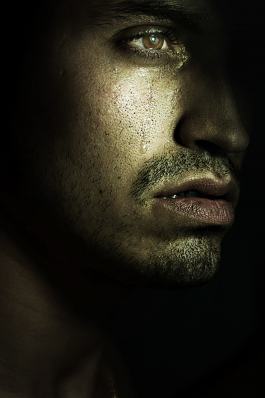 Photograph of a man crying