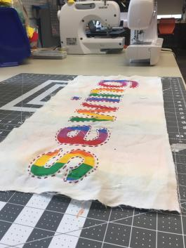 rainbow sewing sign