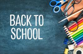 "Blackboard and school supplies with words ""Back to school"""