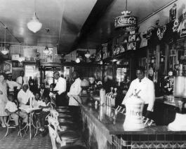 Drug store inside the Arcade Mini-Mall, owned and operated by Charles and Alta Cousins at 725 East Twenty-Sixth Avenue, circa 1935. Black American West Museum