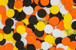 circular yellow, orange, black and white confetti