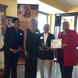 Edna Williams receives the Juanita Gray Community Service Award with Denise Boothby, Zelda DeBoyes and Terry Nelson