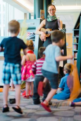 kids jump and sing along with tunes during Storytime at the Central Library