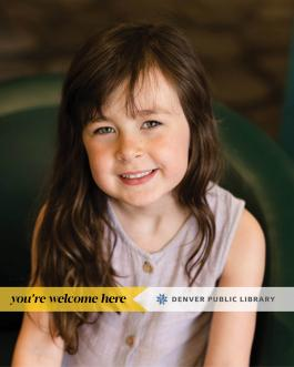 Smiling young girl with a You're Welcome Here banner near the bottom