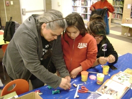Family working together in a Plaza art program.