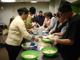 Families preparing tamales at the Woodbury branch.
