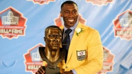 Shannon Sharpe holding NFL Hall of Fame bust