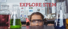 Young girl in laboratory with safety goggles on looking at science experiments